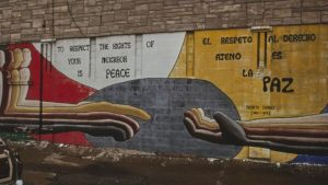 a mural in little village of two hands reaching out